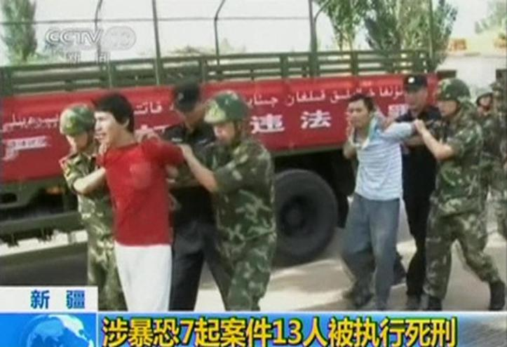 men-who-are-about-to-be-executed-are-escorted-by-riot-policemen-outside-in-this-still-image-taken-from-video-in-an-unknown-location-in-th